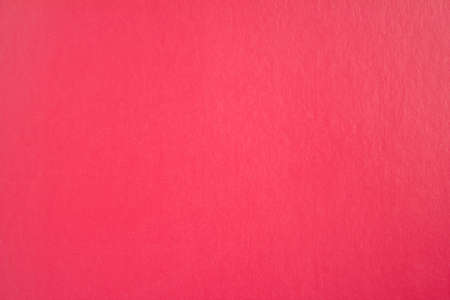 Scarlet red sheet of cardboard paper texture background.