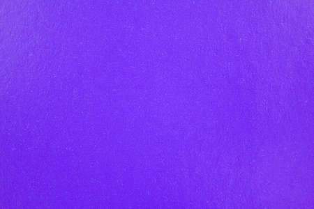 Closeup purple blue sheet of gloss cardboard paper with rough surface texture background.