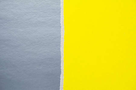 Silver gray and yellow torn cardboard paper texture background. Can be used for text.