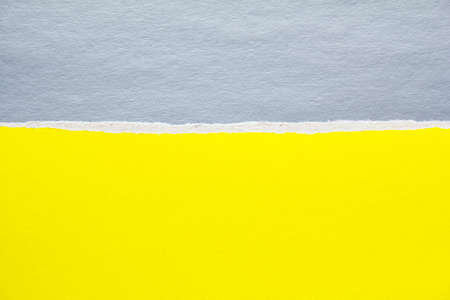 Silver gray and yellow torn sheet of cardboard paper texture background. Can be used for text.