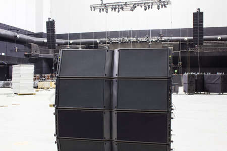 Line array speakers. Stage, trusses, led screen, sound speakers, stage lighting. Professional concert equipment for live show. Stock fotó