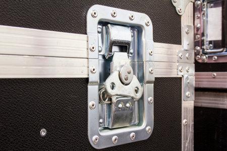 Aluminum lock of flight case. Professional protective box for transporting equipment. Stock fotó