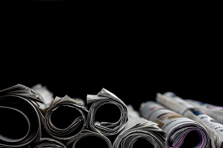 Close up shot of rolled newspapers