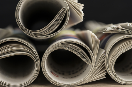 Rolled up newspapers close up