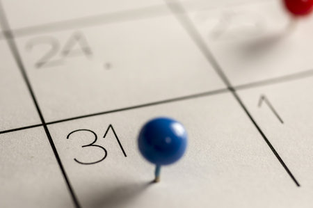 Close up shot of a calendar with a pin on the number 31 Stock Photo