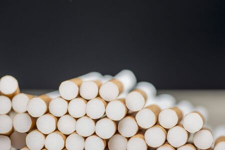 Close up shot of a pile of cigarettes background