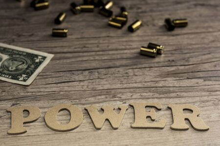The word POWER is assembled with wooden letters