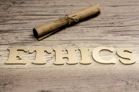 work ethic responsibilities: The word ETHICS is assembled with wooden letters