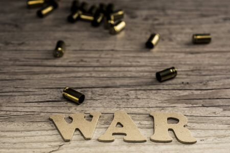 The word WAR is assembled with wooden letters
