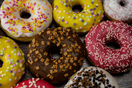 Multiple delicious donuts on table close up shot