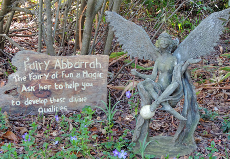 fantastical: Fairy Abbarah sculpture sitting in the garden Editorial