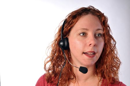 helpdesk: attractive redheaded helpdesk employee or telematketer