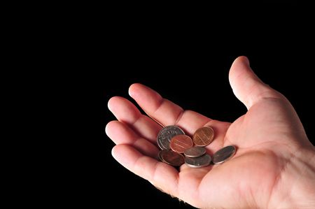 a coin in hand in todays troubled economic times Stock Photo