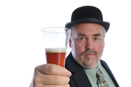 man in a derby hat with a beer Stock Photo - 4319737