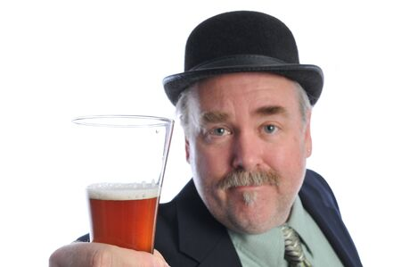 a man with a beer in his hand wearing a derby hat Stock Photo - 4346907