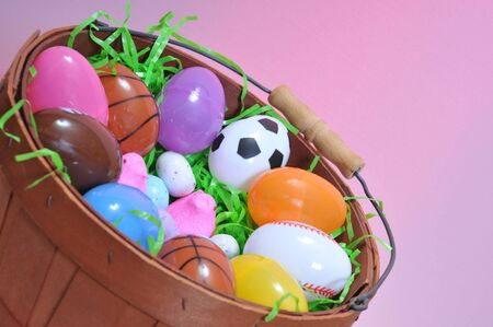 Basket of plastic eggs and candy for easter