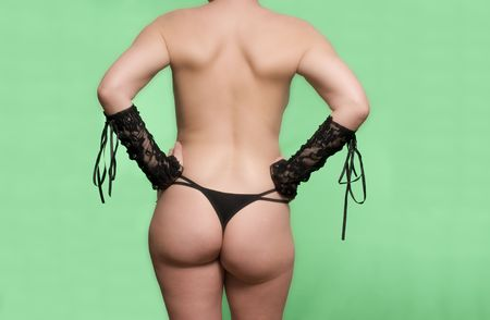 Sexy womans back side in black against a green screen