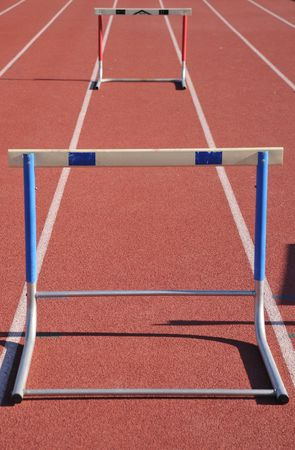 the basic hurdle in a lane or the concept of life and hurdles Stock Photo