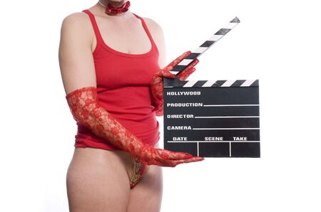 sexy womans body holding a movie clapper on white photo