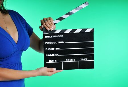 woman holding a clapper board on a green screen Stock Photo - 5118146