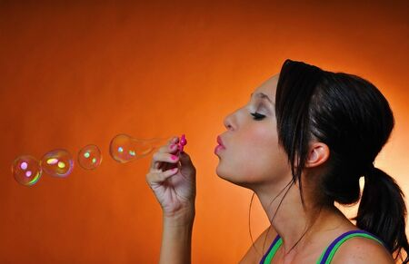 a beautiful young woman having fun with bubbles