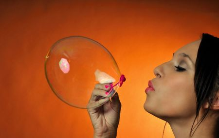 attracive young woman having fun blowing some bubbles Stock Photo - 5296464