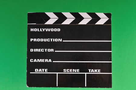 footage: a movie marker or clapper board set against a green screen