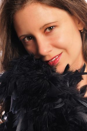 attracive young woman with a bunch of black feathers Stock Photo - 5463327