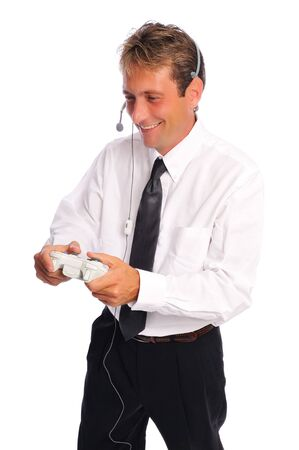 business man taking a break to play video games set on a white background Stock Photo