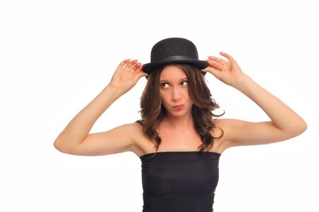 a young woman being silly with a derby hat on a white background Stock Photo - 5478065