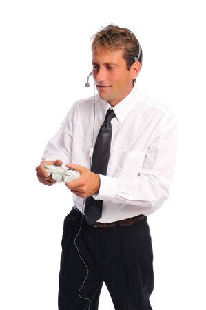 a business man playing video games on a white background Stock Photo
