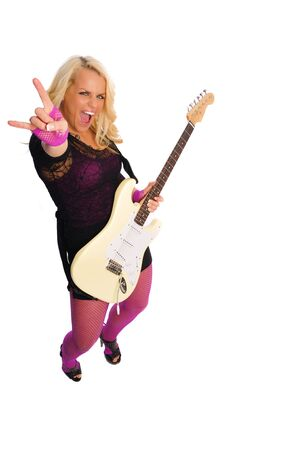 a very attractive blonde woman with a guitar on a white background Stock Photo