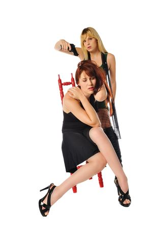 redhead being held hostage at gun point by a blonde woman Stock Photo - 5993582