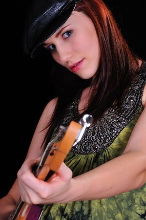 attractive woman with a guitar on white photo