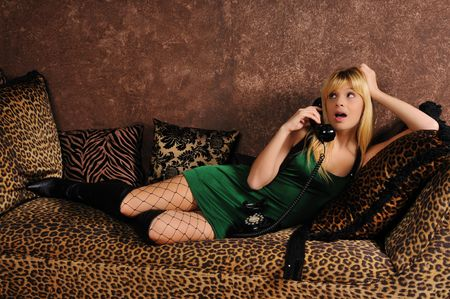 attractive young woman on a couch or sofa Stock Photo - 6302014