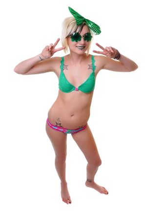 a woman in green with shamrock glasses for st patty's day photo