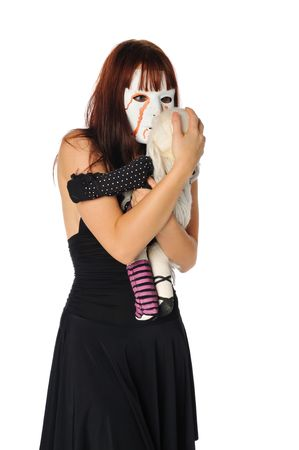 woman with a doll wearing a mask set on white