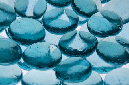 splotchy: some aqua blue glass stones backlit to create a texture abstract Stock Photo