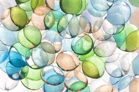 backlite: colorful background texture of backlite glass stones of different sizes