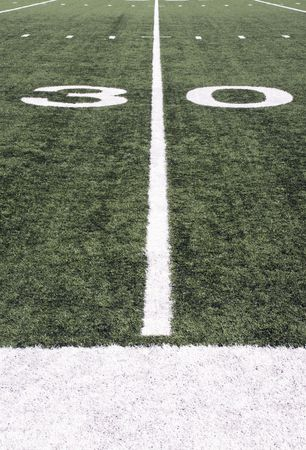 American Football field turf and white painted lines photo