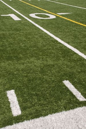 American Football field turf and white painted lines Stock Photo
