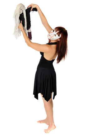 woman wearing a mask dancing with a doll set on white background Banco de Imagens