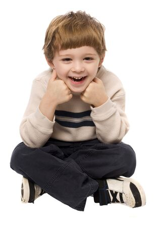 Child having a good time posing on a white background Stock Photo