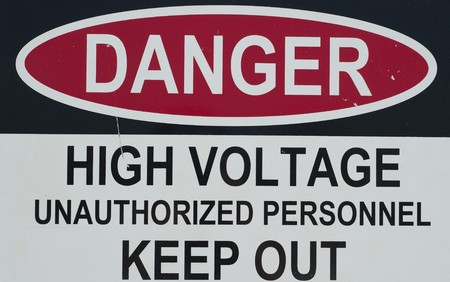 keep out: a sign stating of a high voltage danger and to keep out Stock Photo