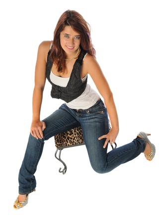 attractive young woman on a stool set on a white background