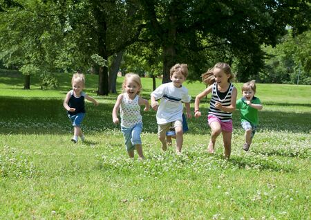 children at play: a child or children at play outdoors in a park Stock Photo