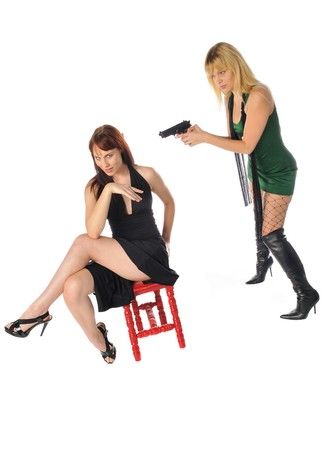 attractive young women one with a gun set on a white background Banco de Imagens