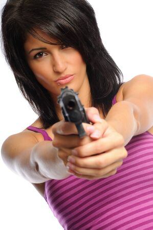 attractive young hispanic woman on a white background holding a pistol Stock Photo - 7458420