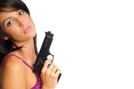 attractive young hispanic woman on a white background holding a pistol Banco de Imagens