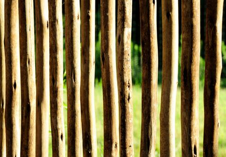 wooden fence on a farm made of rough cut branches